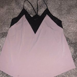 Pink and black Express top with lace detail.